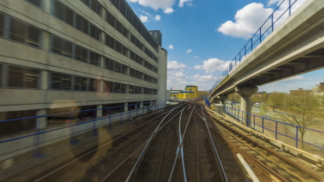 train drive lapse footage of docklands light railway train passing through london's docklands. - train point of view stock videos and b-roll footage