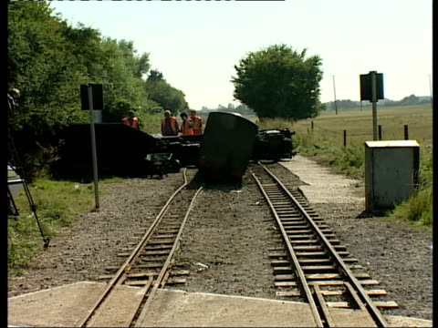 train driver killed in level crossing crash meridian = no kent nr burmash wreckage of car next level crossing zoom in wreckage of tourist steam train... - tourist train stock videos and b-roll footage