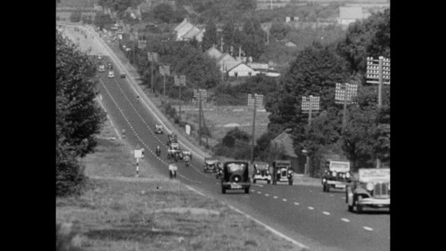 montage train driving through city and vacation spots / england, united kingdom - anno 1936 video stock e b–roll