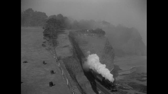 ts train emerging from a tunnel / united kingdom - locomotive stock videos & royalty-free footage