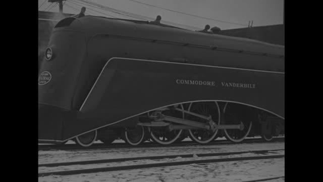 cu train engine with new york central lines on front at station in snow / commodore vanderbilt train engine moves backward on tracks / train moves... - locomotive stock videos & royalty-free footage