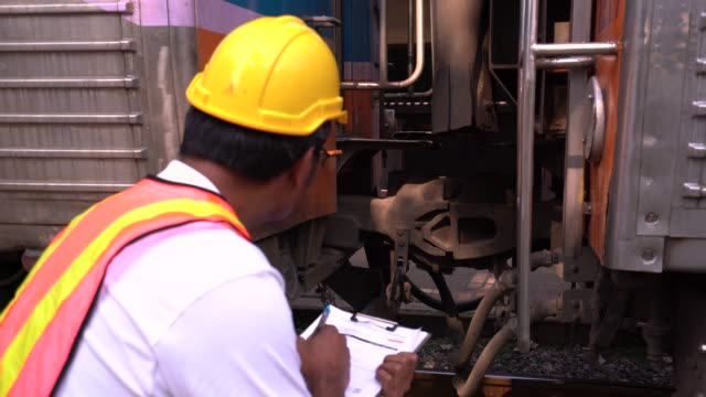 train engineer checking engine - transport conductor stock videos & royalty-free footage