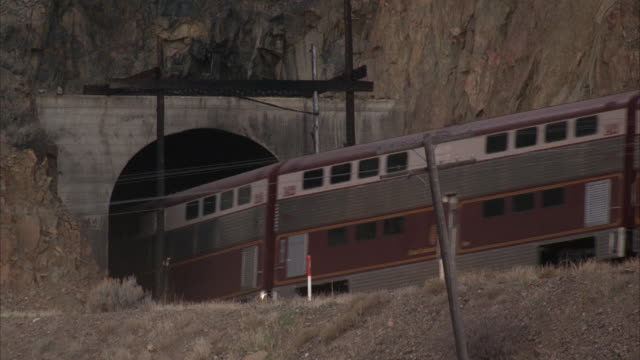 stockvideo's en b-roll-footage met ms, train entering mountain tunnel, usa - tunnel