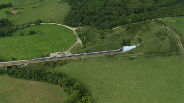 AERIAL WS ZI PAN TGV train entering tunnel west of Grenoble / Isere, France