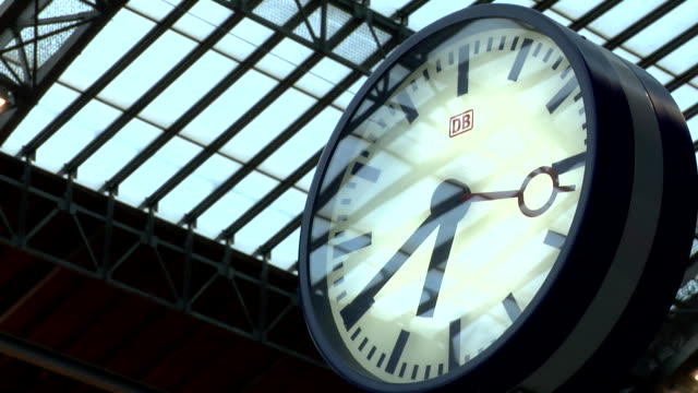 train from Dresden arrives people leaving the train station clock long shot train departs filmed from inside leaving the main station filmed from the...