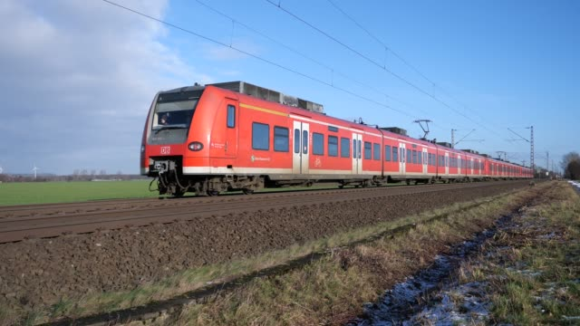 train from the deutsche bahn (db) between osnabrück and hannover - rail transportation stock videos & royalty-free footage