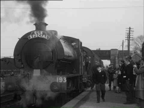 MS Train going through tunnel, and crossing bridge / Barmouth, Gwynedd, Wales