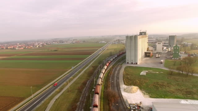aerial train heading through industrial area - slovenia stock videos & royalty-free footage