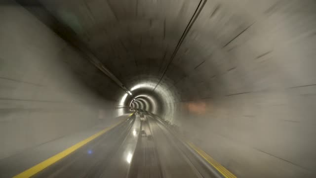 4k train in the tunnel with motion blur at the airport - tunnel stock videos & royalty-free footage