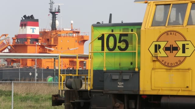 train infront of oil tankers in the docks at amsterdam, netherlands. - in front of stock videos & royalty-free footage