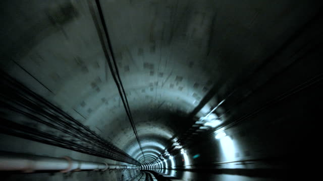 train intersecting through the tunnel - tunnel stock videos & royalty-free footage