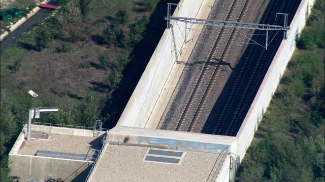 Train into tunnel - Aerial View - Provence-Alpes-Côte d'Azur, Vaucluse, Arrondissement d'Avignon, France