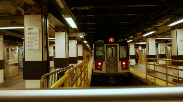 Train is leaving New York subway train station in Flushing, Queesns