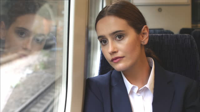 train journey business woman commuter. - ponytail stock videos & royalty-free footage