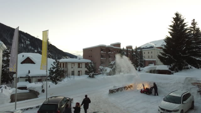 train journey from zurich to davos and some general scenes of passengers at the station and someone plowing the snow on sunday january 20 2019 - ダボス点の映像素材/bロール