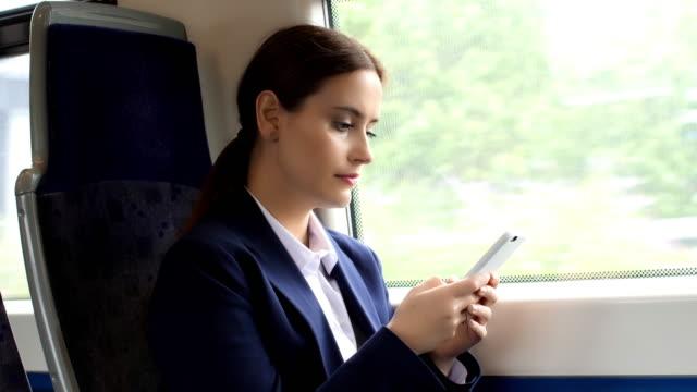 stockvideo's en b-roll-footage met treinreis telefoon. mooie jonge vrouw. - passenger train