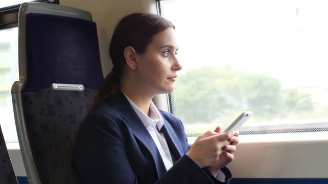 train journey phone message woman. - ponytail stock videos & royalty-free footage