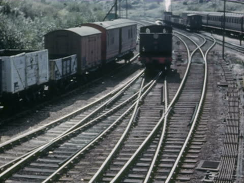 stockvideo's en b-roll-footage met ws train journey through rural areas and men pulling levers witching the lines / various including banbury, shrewsbury, cambrian coast, wales - commercieel landvoertuig