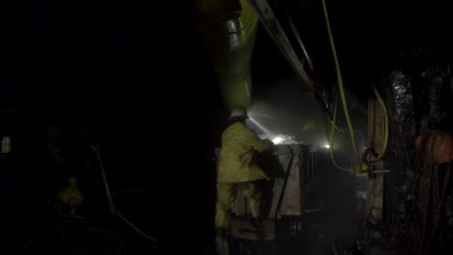 train leaves on mine railway. miner jumps on last wagon. - miner stock videos and b-roll footage