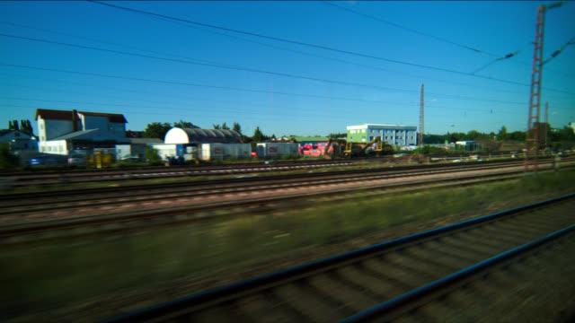 train leaves station, railway tracks and houses, blue sky, Saarlouis, Saarland, Germany