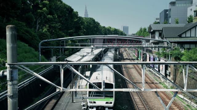 train leaving harijuku station - footbridge stock videos & royalty-free footage