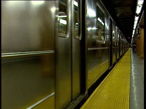 train leaving metro station new york - bbc news stock videos and b-roll footage