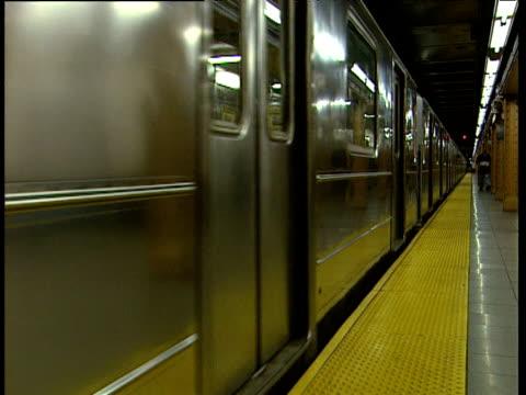 train leaving metro station new york - bbc news bildbanksvideor och videomaterial från bakom kulisserna