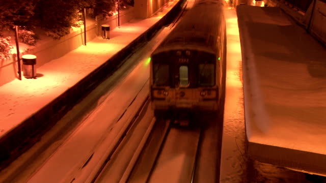 lirr train leaving the great neck ny station during a snowstorm - long island railroad stock videos and b-roll footage