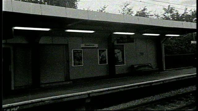 train leaving uk rail station on bw super 8 film - grainy stock videos & royalty-free footage