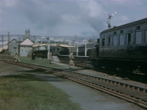 vídeos y material grabado en eventos de stock de ms ts train loading with coal and goods  passing through bushy mountain station \ mauritius - escritura occidental