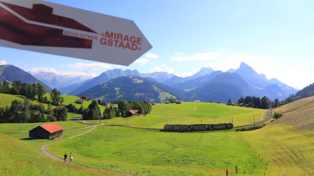 "train moves by near ""mirage gstaad"" by los angeles-based artist doug aitken is on display outside as installation sculpture representing a chalet... - kaleidoscope pattern stock videos & royalty-free footage"