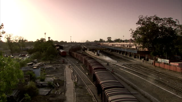 .a train moves down train tracks in india available in hd - c119gs stock videos & royalty-free footage