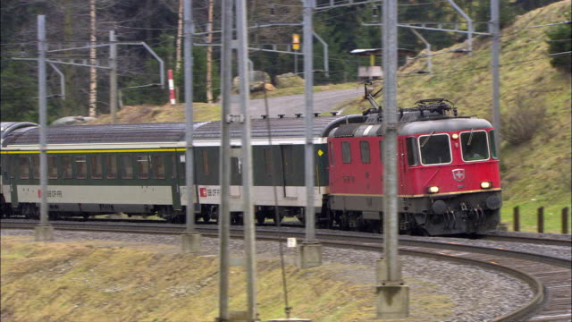 ms pan train moving along railway tracks / wassen, uri canton, switzerland - 2007 stock videos & royalty-free footage