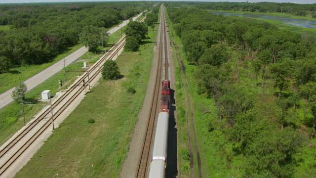 ws aerial pov train moving from rural area / lake county, gary, indiana, united states - indiana stock videos & royalty-free footage