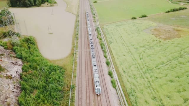 train moving in landscape, aerial view from above - commuter train stock videos & royalty-free footage