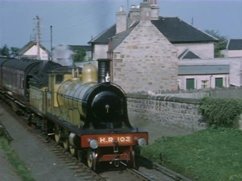vídeos de stock, filmes e b-roll de ms cu  train moving in shed and details of train and name plate wheels / united kingdom - 50 segundos ou mais