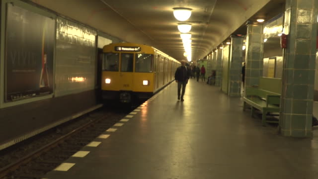 Train moving into and out of underground station in Germany