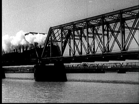 1935 WS Train moving over river on truss bridge producing stream of exhaust/ AUDIO