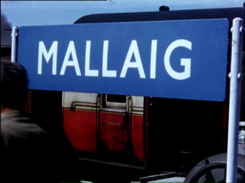 ws train moving slowly along coast and through highlands across viaducts, at mallaig footage of the boats / fort william, maillaig, highlands, scotland - scottish highlands stock videos and b-roll footage