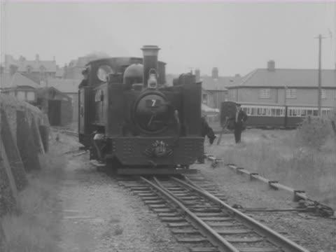 ms cu train moving slowly along ship side / southampton, london and brighton, england  - southampton england stock videos and b-roll footage