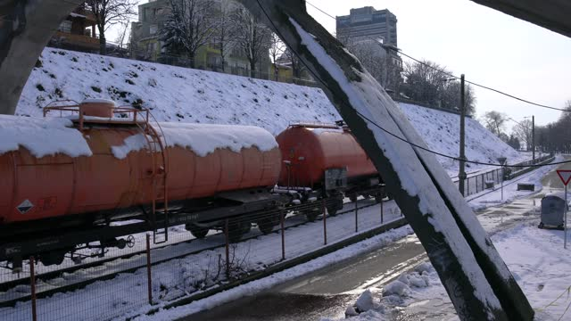 a train moving towards the camera on rail tracks covered with snow - pavel gospodinov stock videos & royalty-free footage