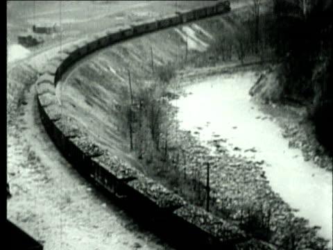 stockvideo's en b-roll-footage met 1927 b/w ha ws train of coal mine carts moving past carrying bituminous coal/ pennsylvania, usa - 1927