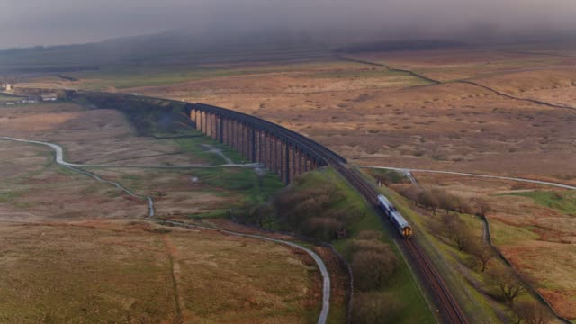 train on northern end of ribblehead viaduct - drone shot - england stock videos & royalty-free footage
