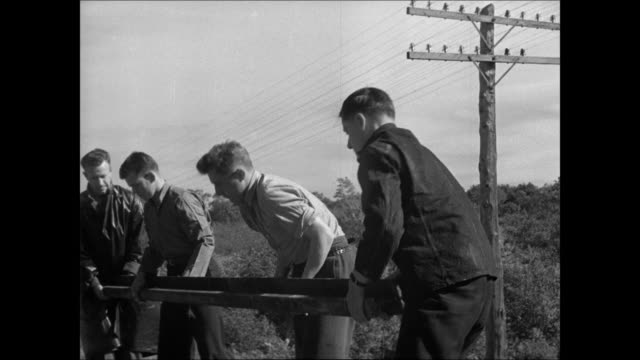 train on railroad track norwegian rebels hammering rail tracks men lifting rail tossing rail down hill. - nazism stock videos & royalty-free footage