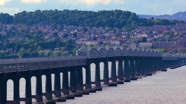 train on tay rail bridge, dundee, scotland, uk - dundee scotland stock videos and b-roll footage
