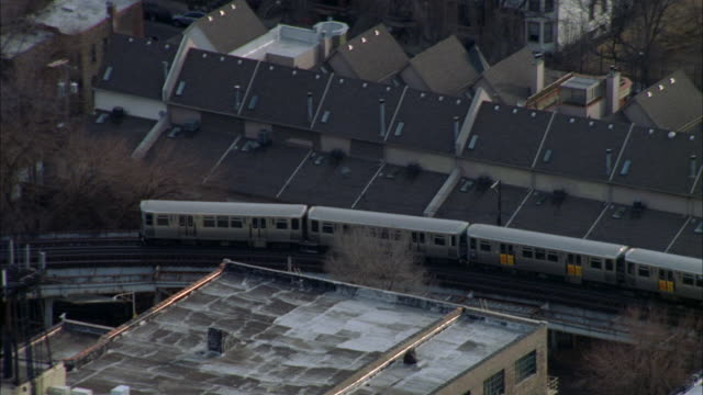 a train on the 'l' passes apartment buildings in a chicago neighborhood. - chicago 'l' stock videos & royalty-free footage