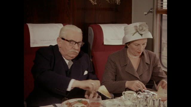 1960 - train passengers eating breakfast, uk - compartment stock videos & royalty-free footage
