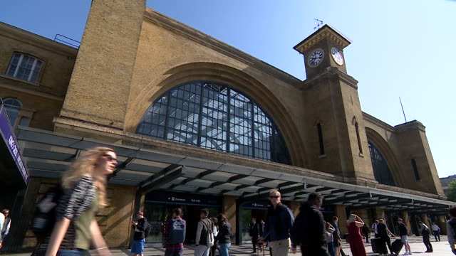 Train passengers outside King's Cross Station includes anonymous shots