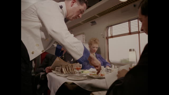 1960 - train passengers served breakfast, uk - compartment stock videos & royalty-free footage