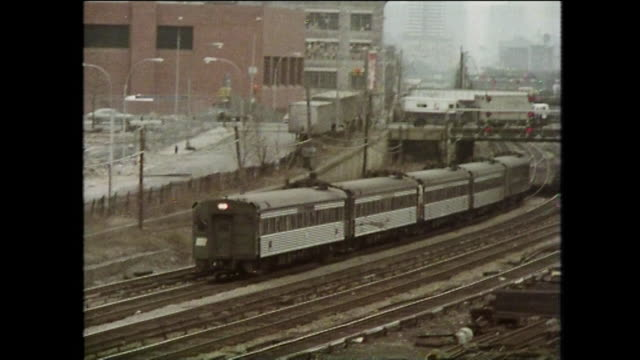 train passes derelict buildings; new york city, 1975 - general view stock videos & royalty-free footage